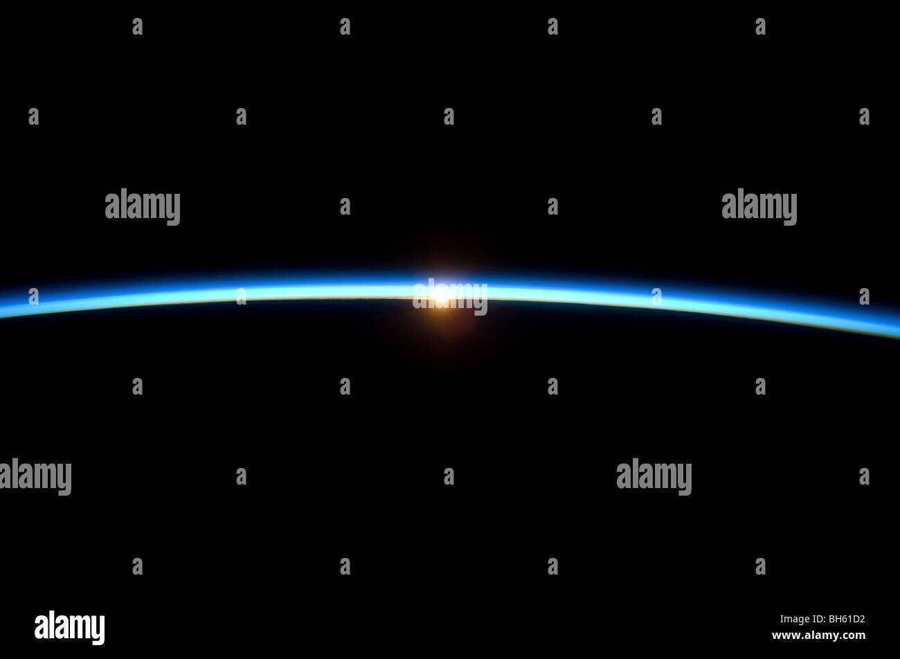 November 23, 2009 - The thin line of Earth's atmosphere and the setting sun. - Stock Image