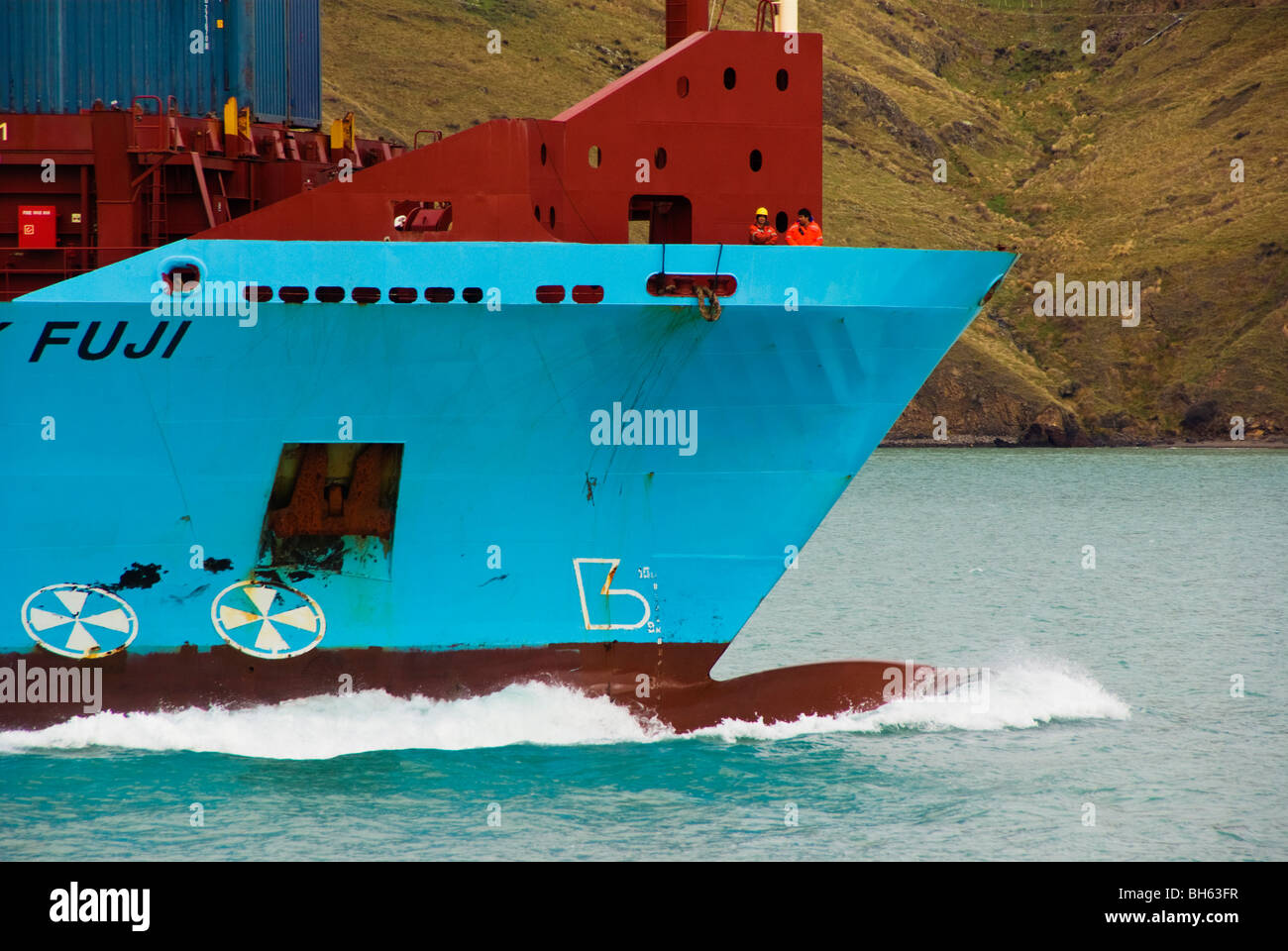 Bulbous bow and bow wave of a container ship is it moves through the water. - Stock Image