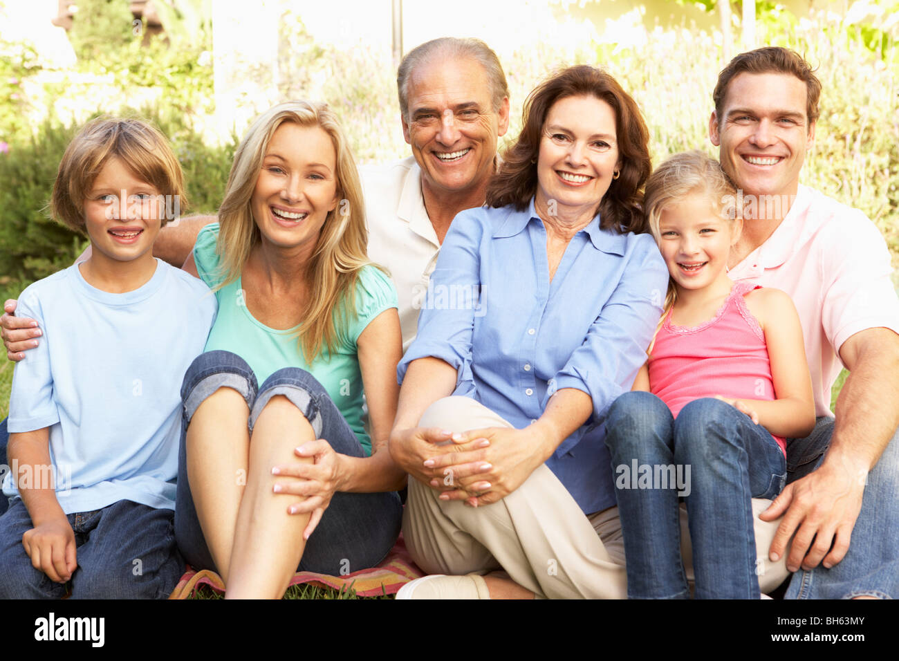 Extended Group Portrait Of Family In Garden - Stock Image
