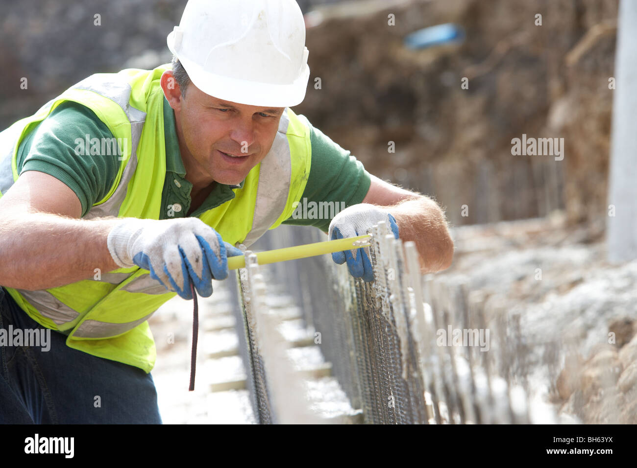 Construction Worker Holding Measure - Stock Image