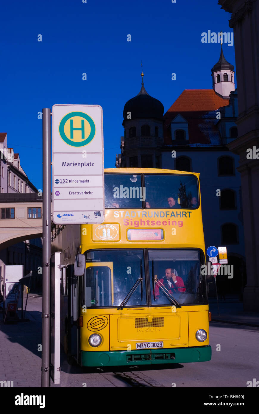 Sightseeing bus Marienplatz square Munich Bavaria Germany Europe - Stock Image