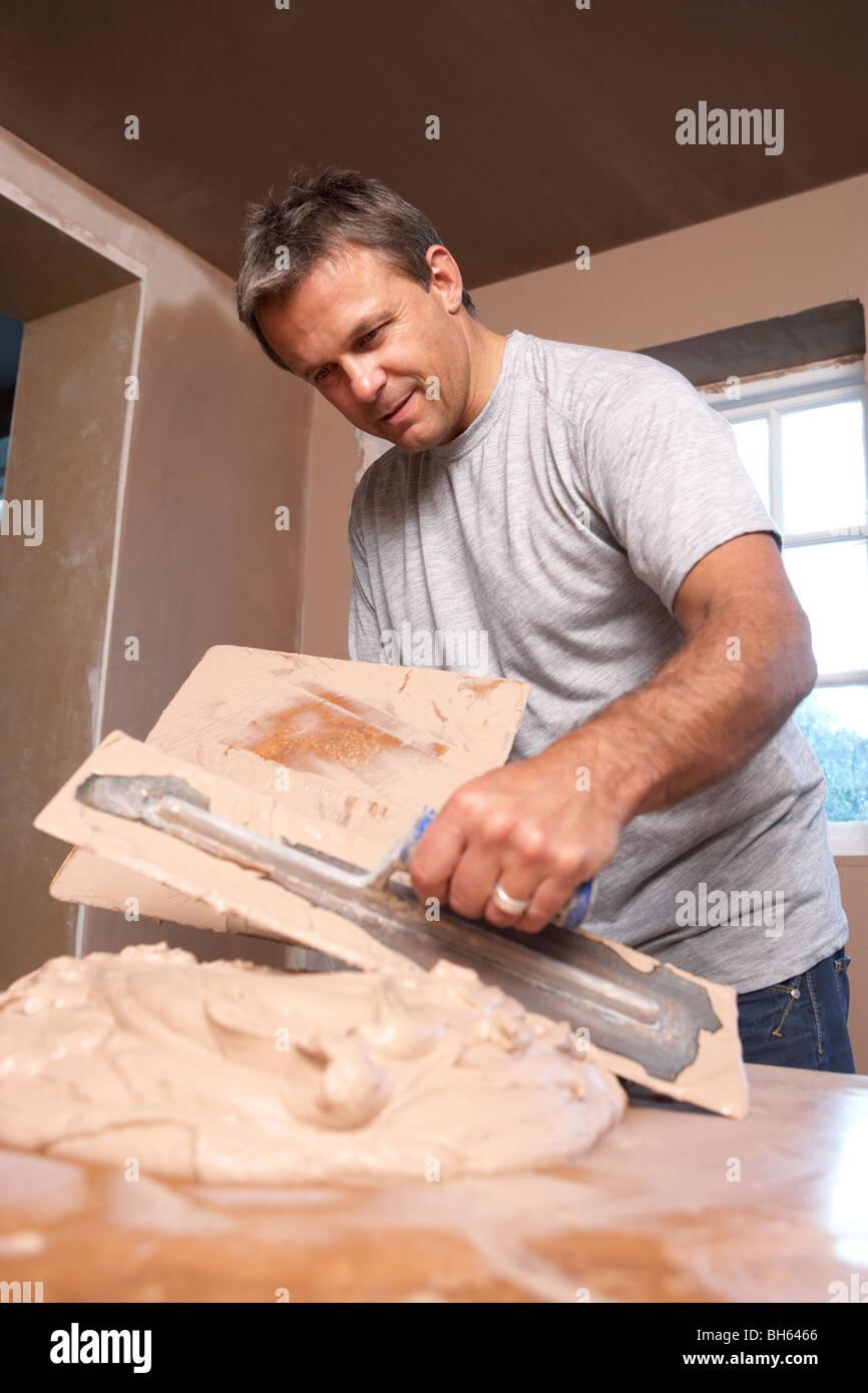 Plasterer Mixing Plaster Stock Photo
