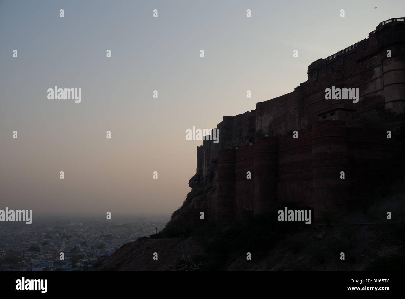 Silhouette of Mehrangarh Fort  with Jodhpur bellow. India. Stock Photo