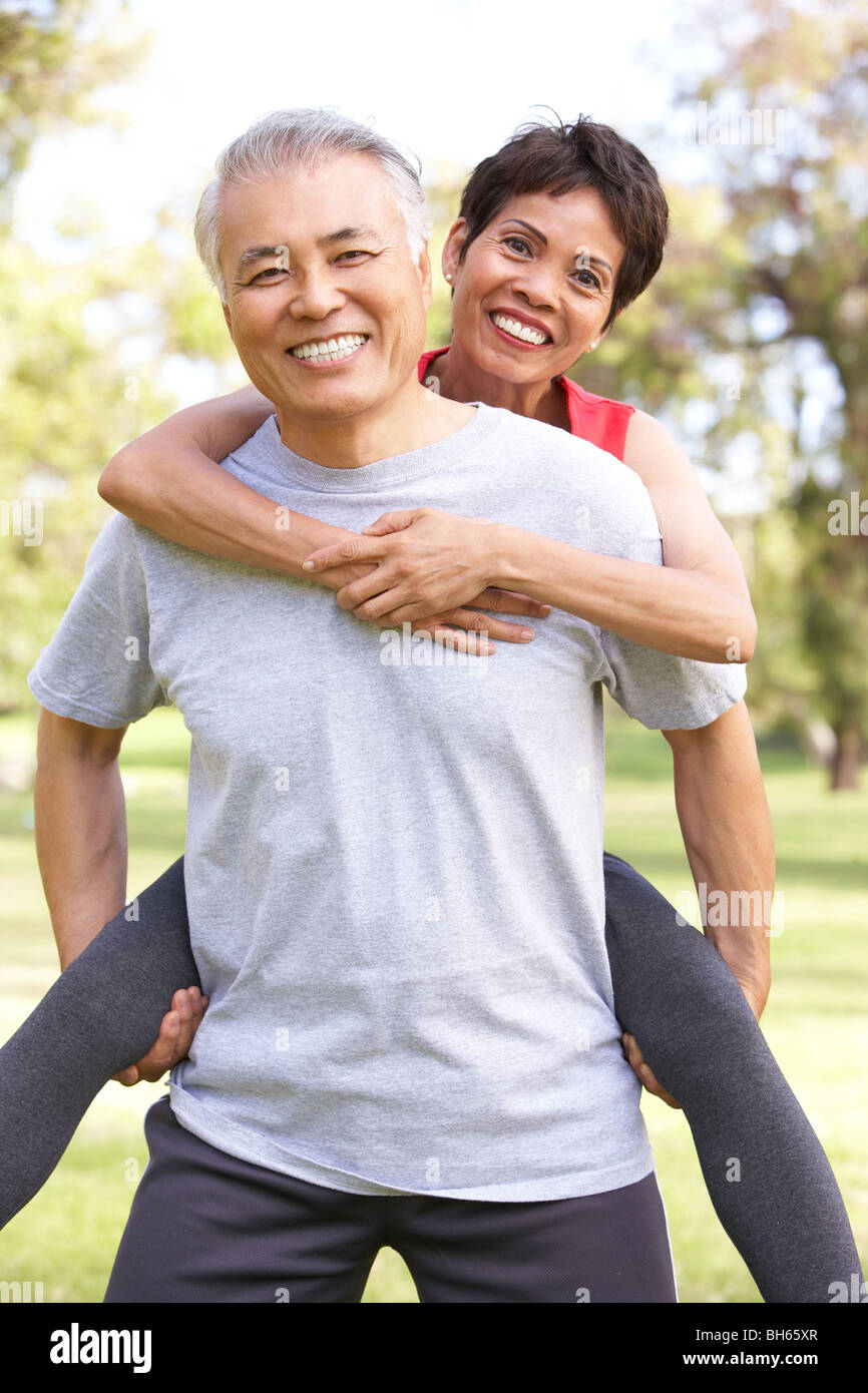 Senior Couple Working Out In Park - Stock Image