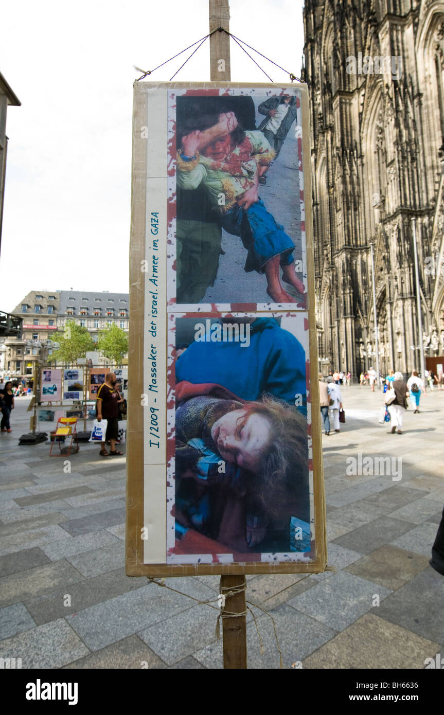 Graphic placards depicting the alleged Israeli war crimes in Gaza and angry crowd - Stock Image