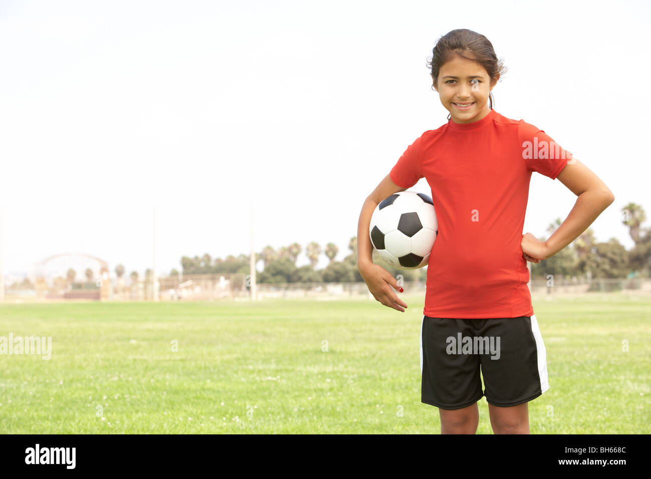 Young Girl In Football Team - Stock Image