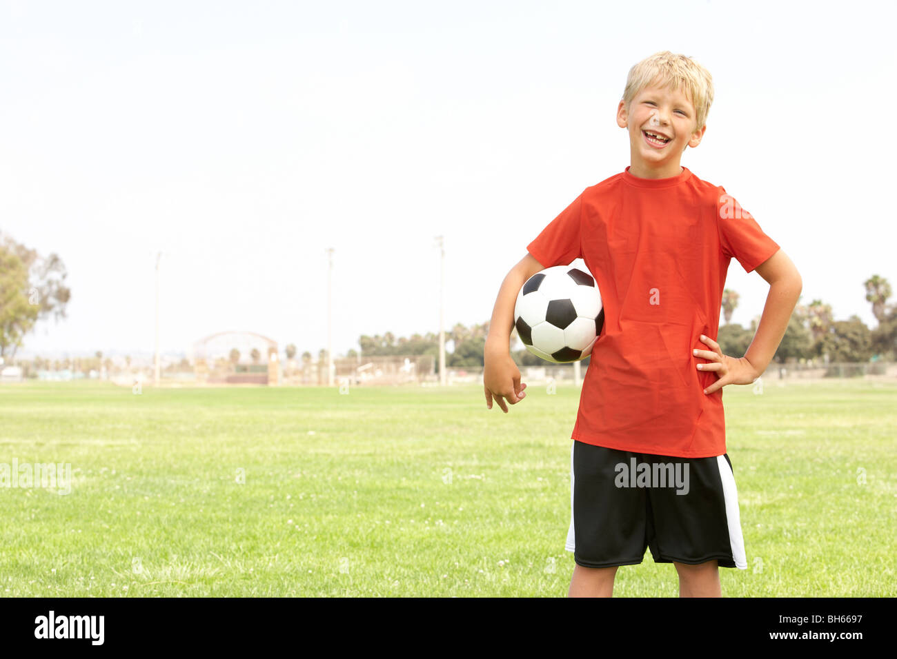 Young Boy In Football Team - Stock Image