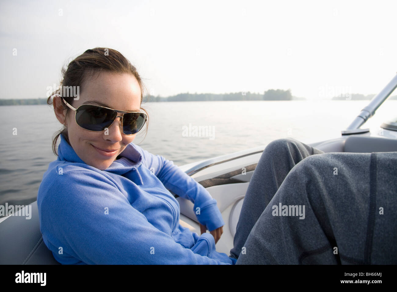 Woman relaxing in boat Stock Photo