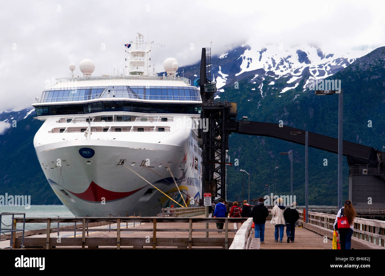 Passengers headed back to The Norwegian Star cruise ship after a day of shopping and sightseeing in Skagway Alaska. - Stock Image