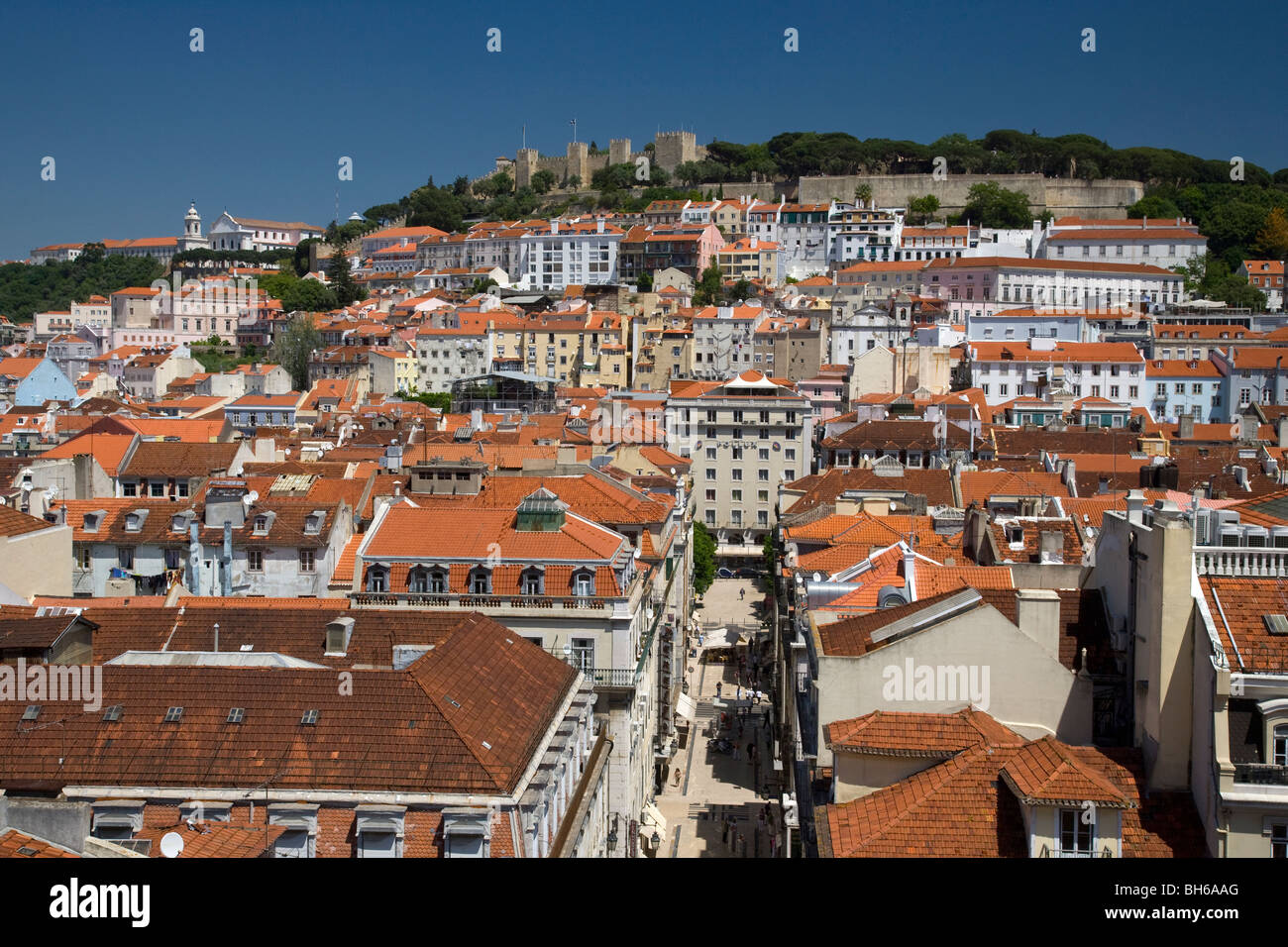 High View over city rooftops and Baxia district of Lisbon, Portugal  towards Castelo de sao jorge which dominates - Stock Image