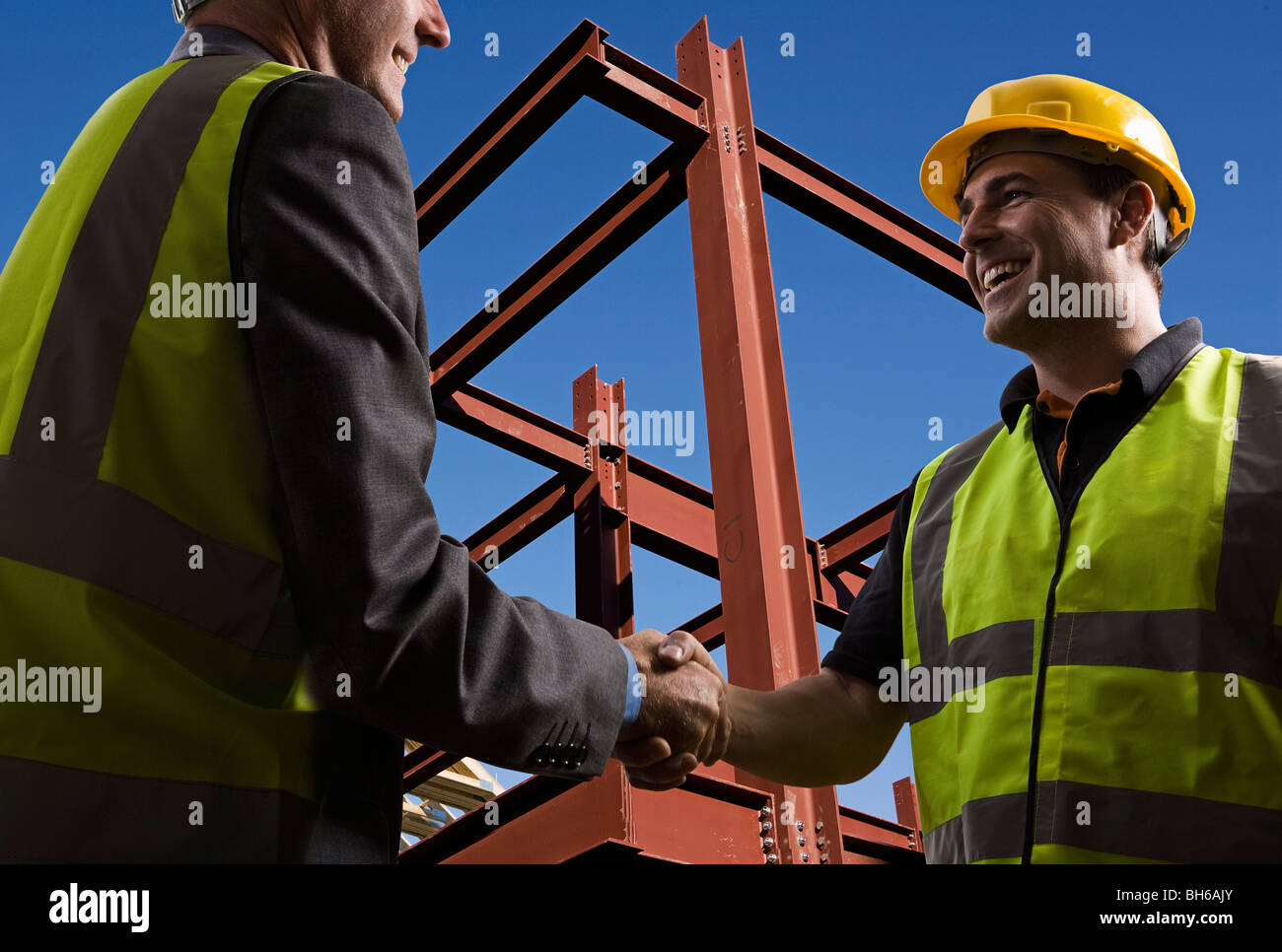 Agreement at construction site - Stock Image