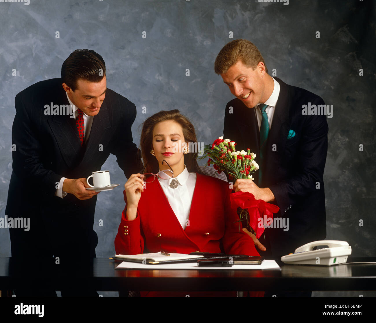 One woman and two men in office situation - Stock Image