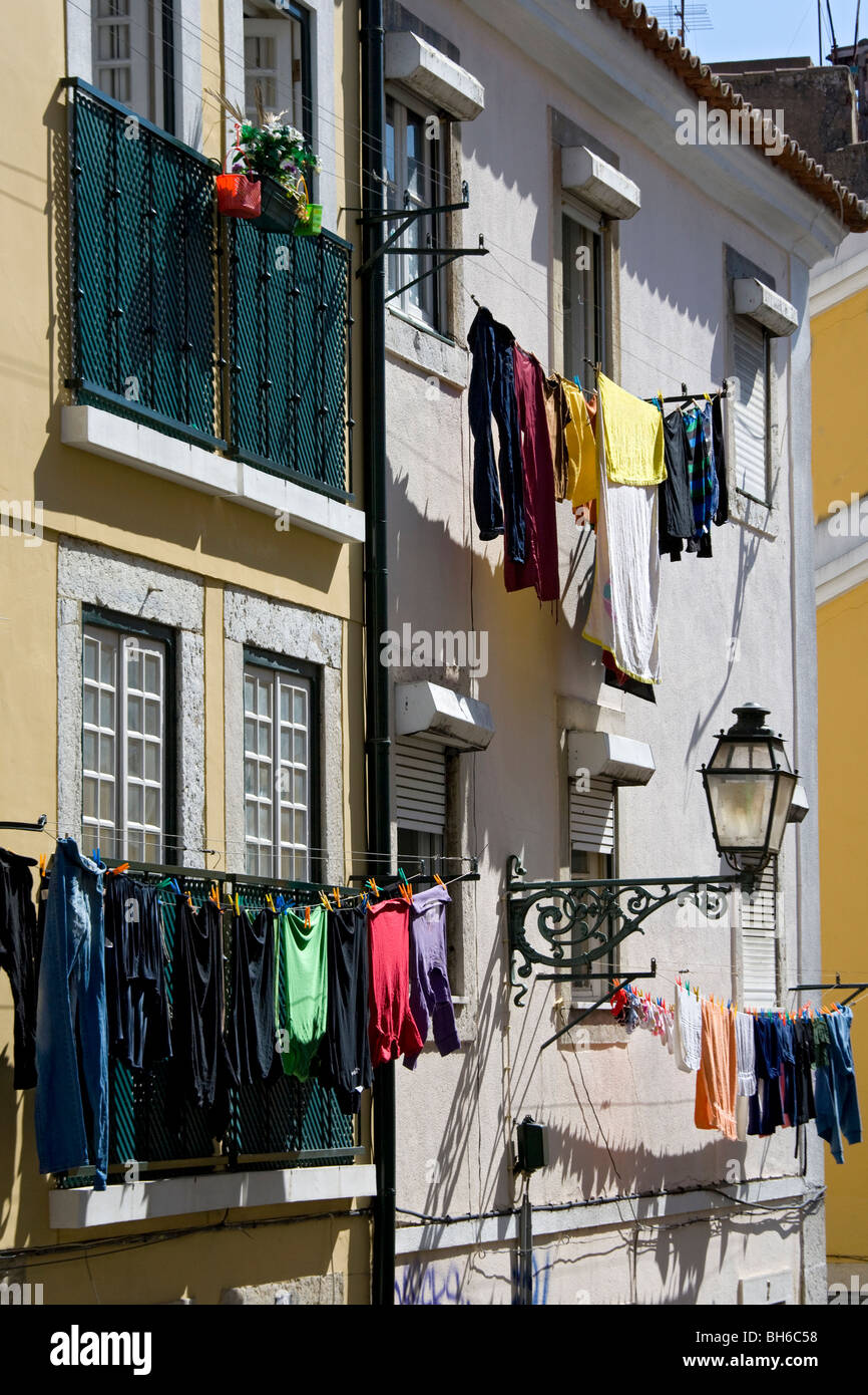 washing hanging up in beautiful old houses in the labyrinth of narrow alleyways of the Alfama quarter of Lisbon,portugal,europe - Stock Image