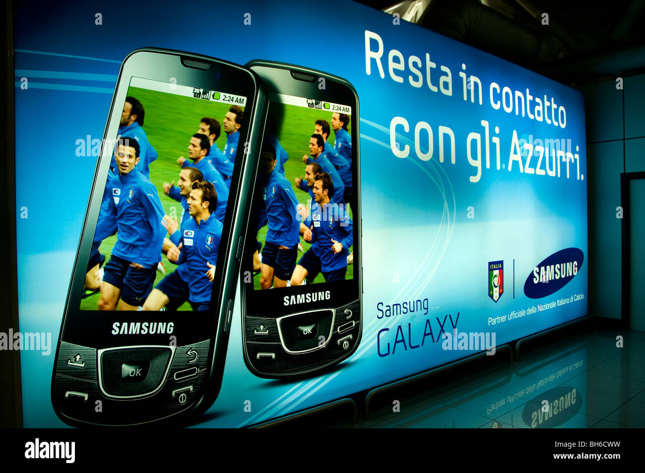 cell cellular phone Soccer Football Samsung Airport Rome Italy telephone - Stock Image