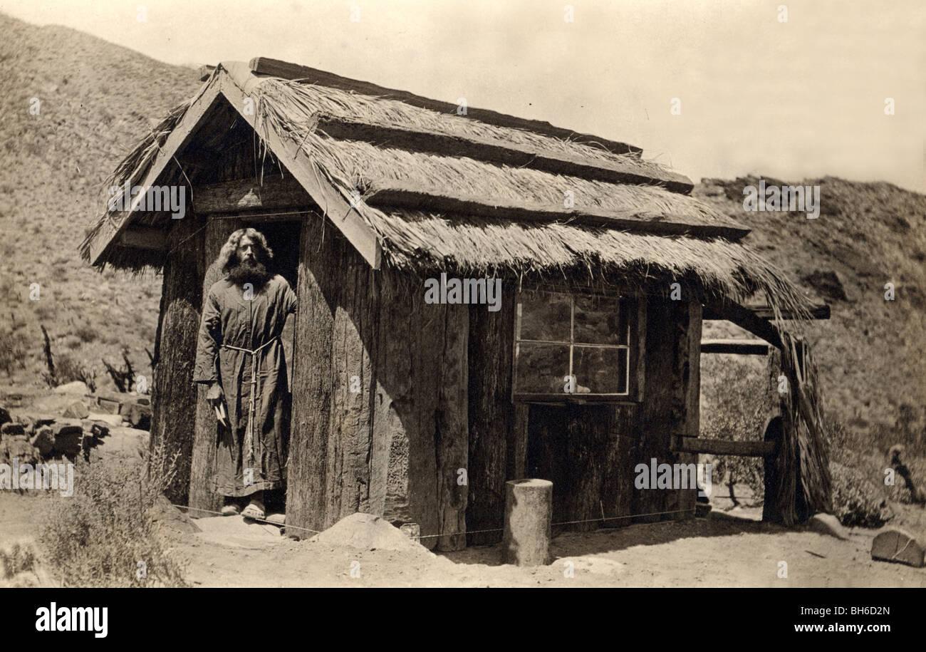 Eccentric Hermit at Desert Log Cabin - Stock Image