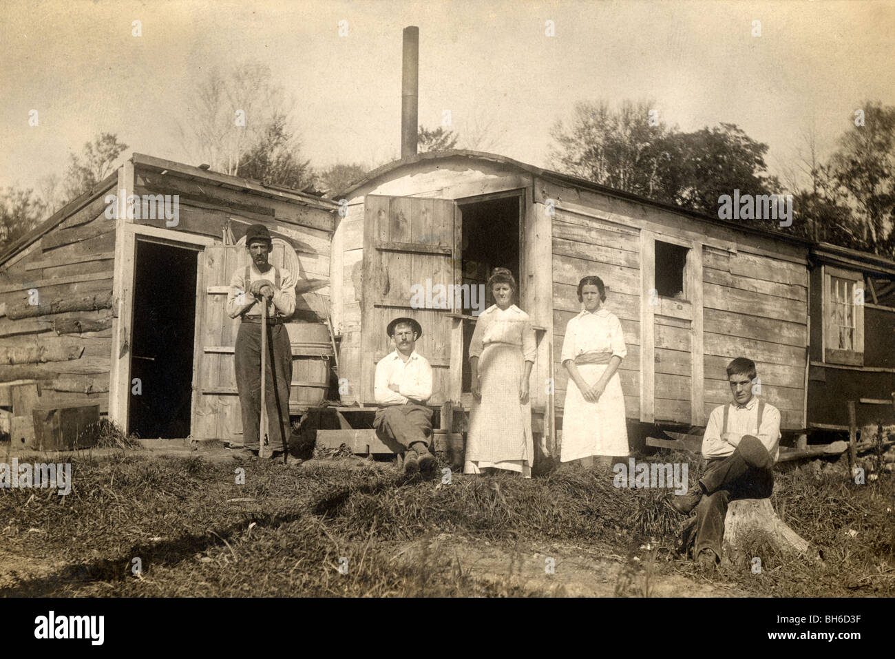 Family of Five People at Converted Cabin - Stock Image