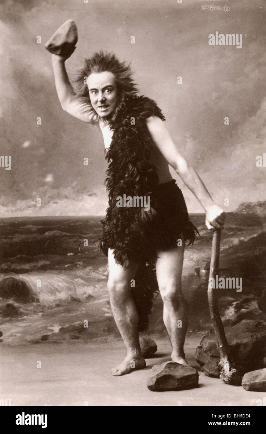 Caveman with Shillelagh  Brandishing a Rock - Stock Image
