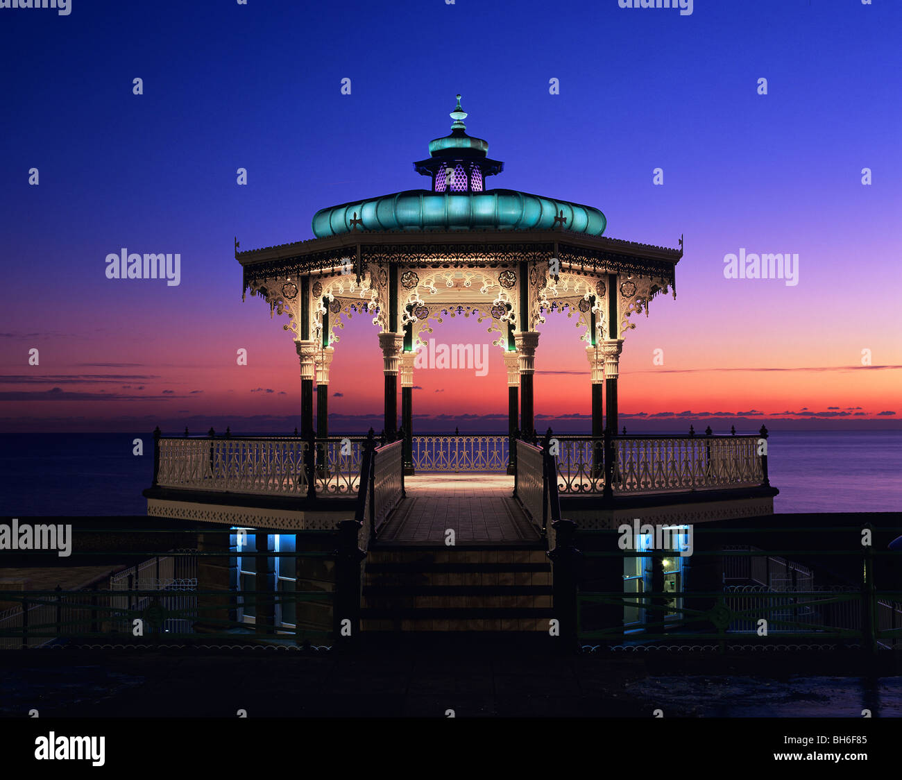 Victorian shelter on the seafront promenade, Brighton and Hove, East Sussex. The shelter, built in 1884, was restored Stock Photo
