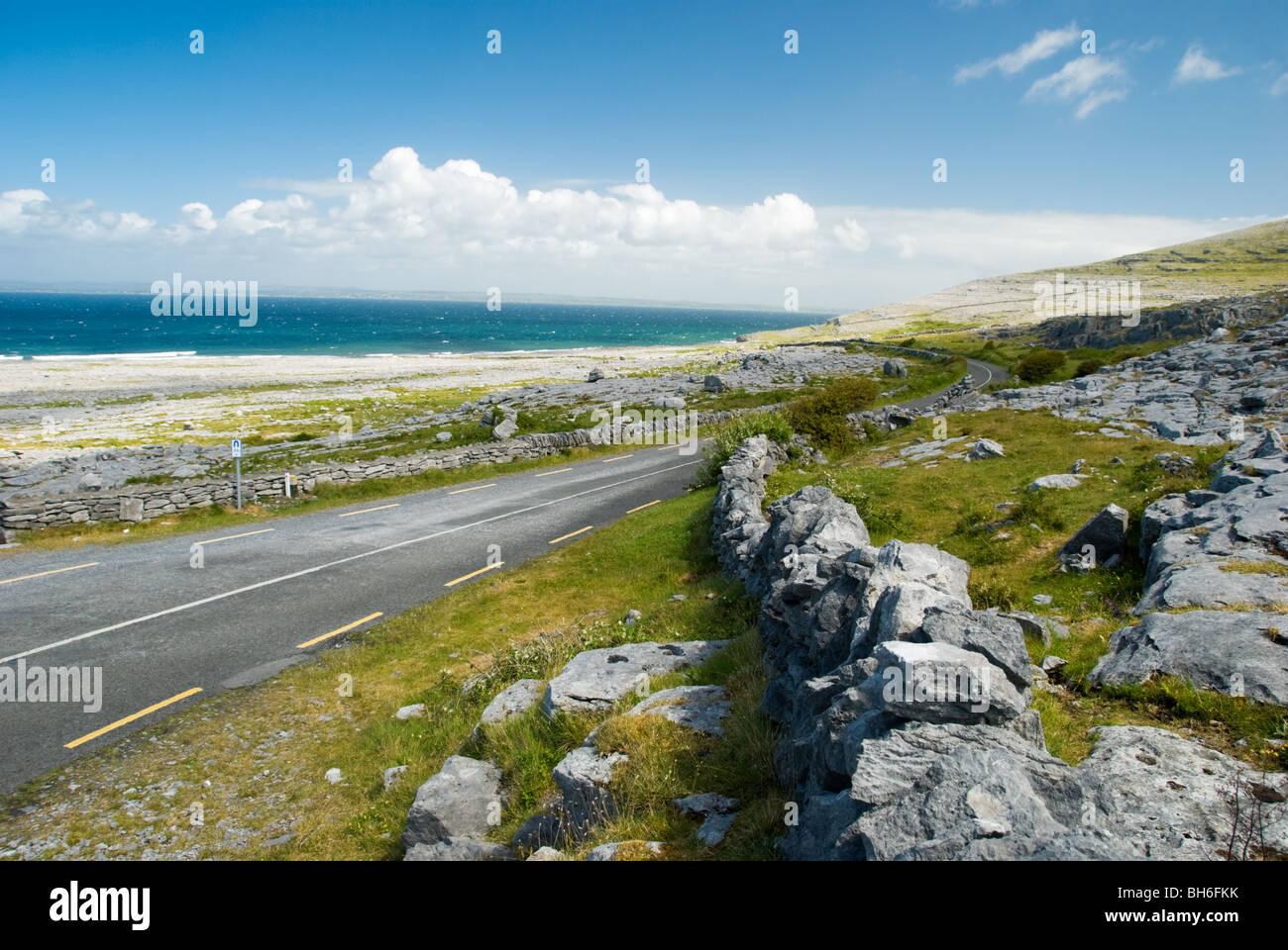 The coastal road in the Burren, looking towards Black head. Stock Photo