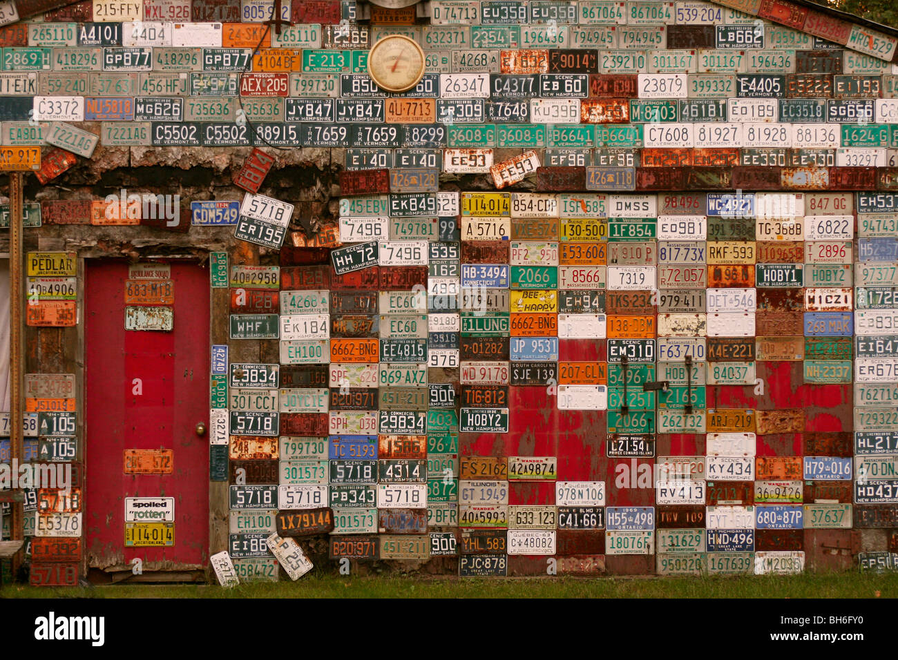 wall of metal car license plates on garage with red door & wall of metal car license plates on garage with red door Stock Photo ...