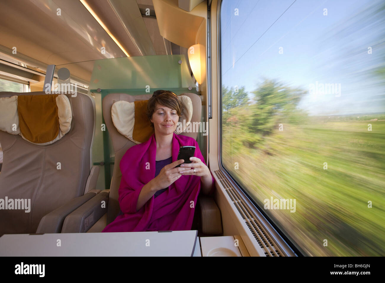 A woman on train - Stock Image