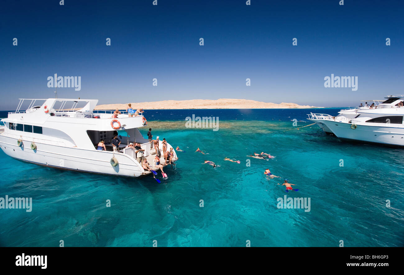 Tourist dive boats at sea Stock Photo