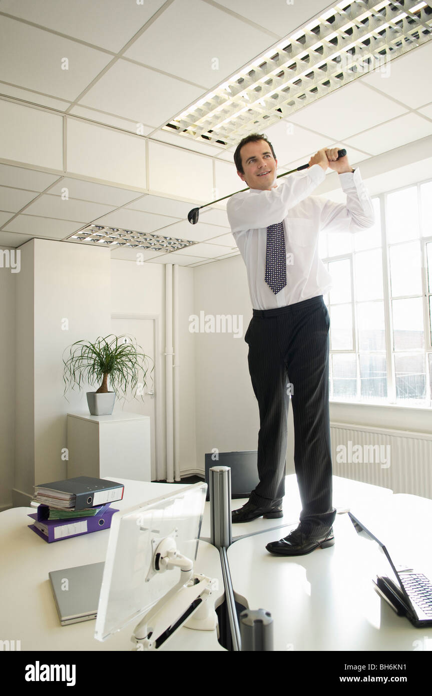 Business man playing golf - Stock Image