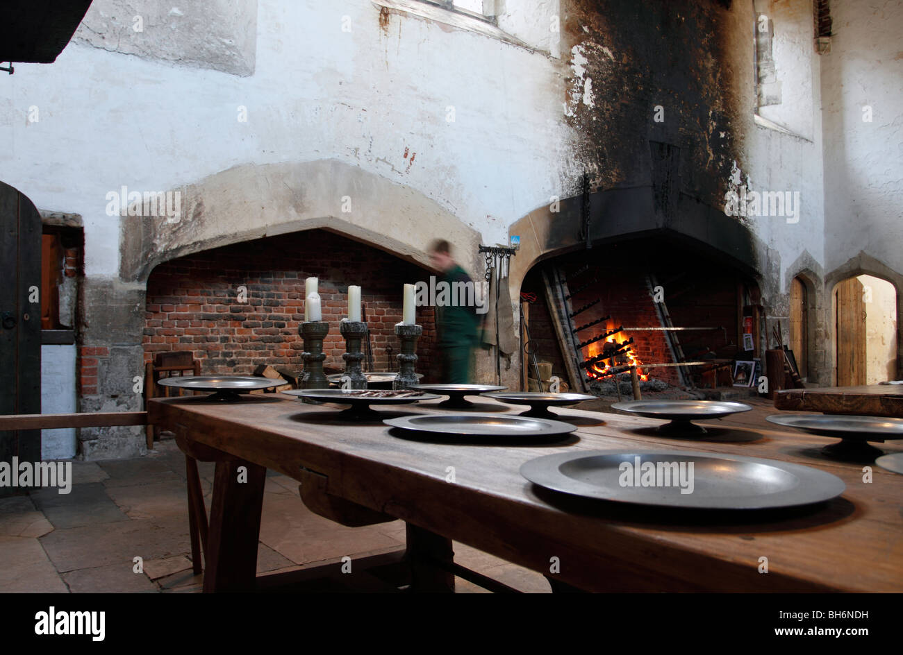 The roasting fire on the right of the great kitchens at Hampton Court Palace. Now divided into three large rooms. - Stock Image