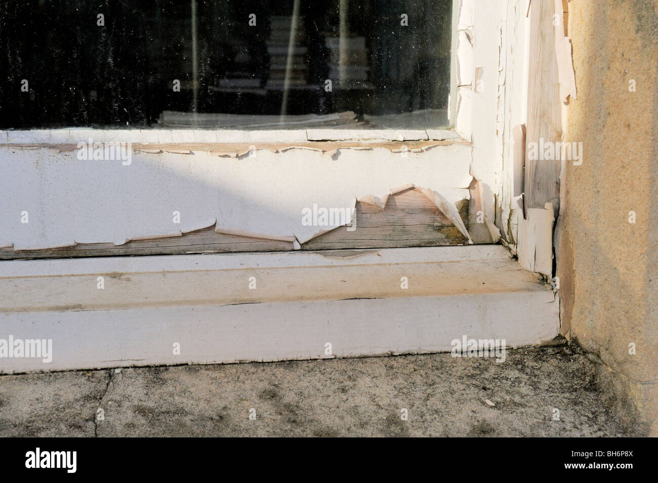 Flacking paint on poorly maintained wooden window Stock Photo