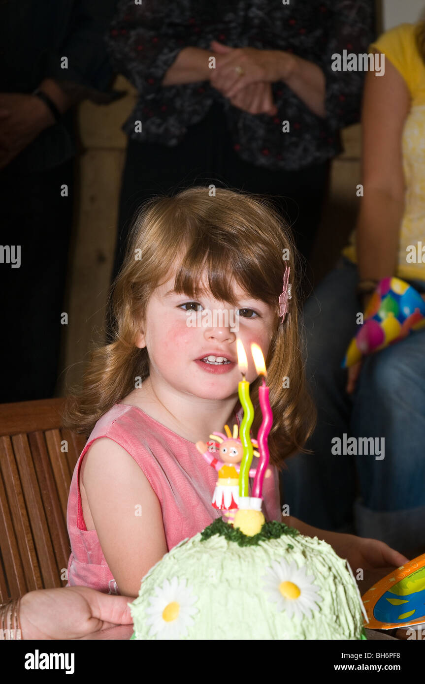 Dh GIRL UK Two Year Old Looking At Her Birthday Cake Candles Child Uk