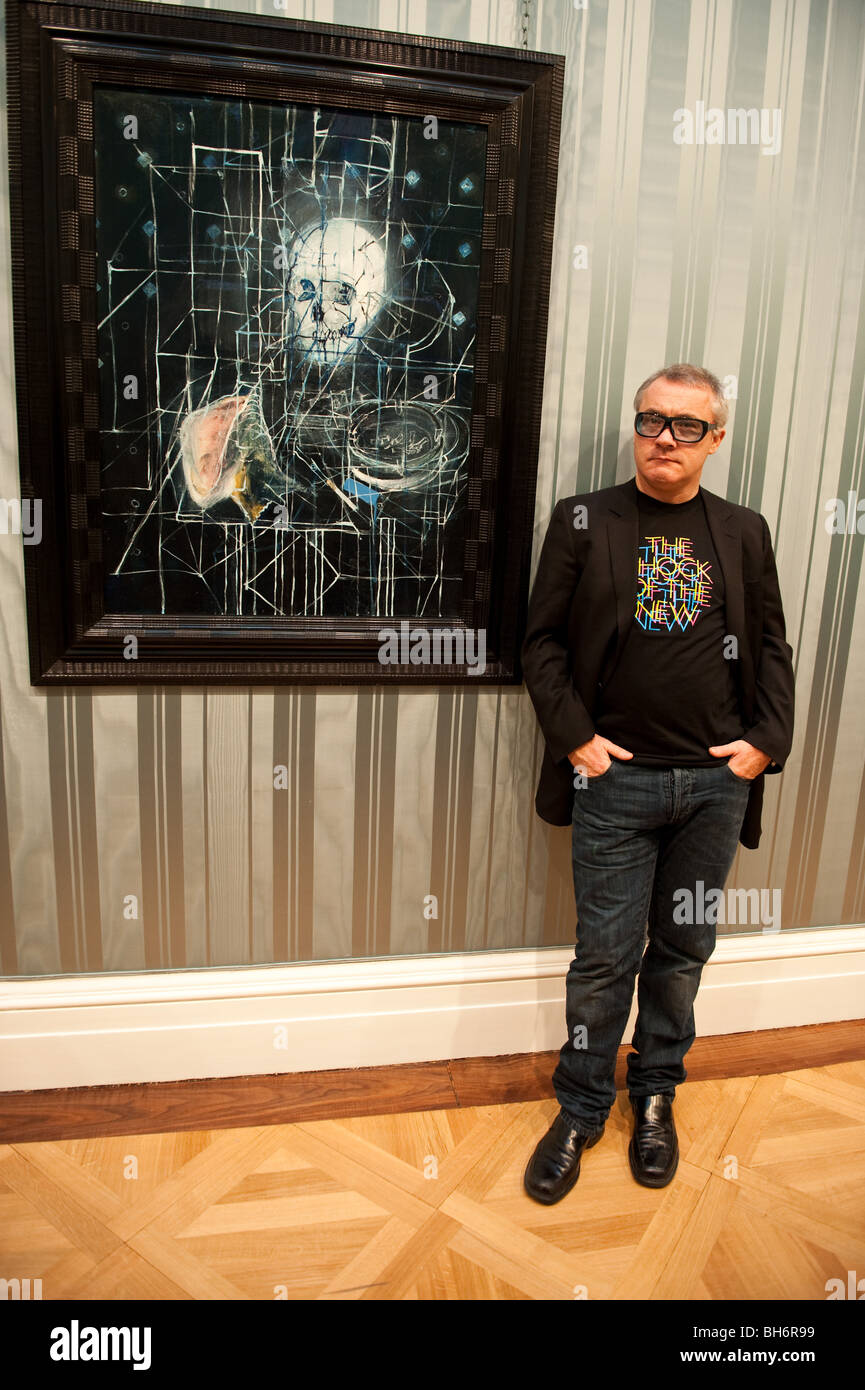 Damian Hirst in front of his  painting 'Skull with ashtray' - Stock Image