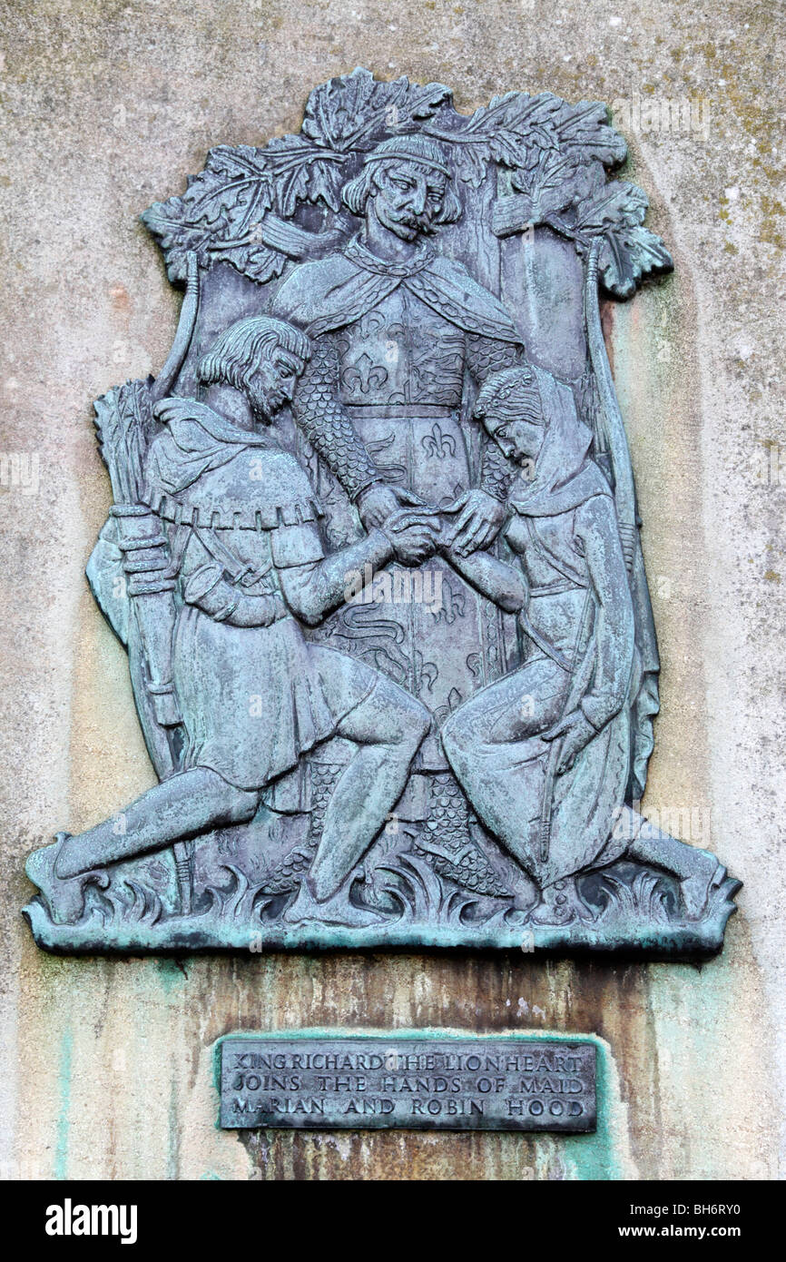 wall plaque showing king richard the lion heart joins the hands of robin hood and maid marian castle road nottingham - Stock Image