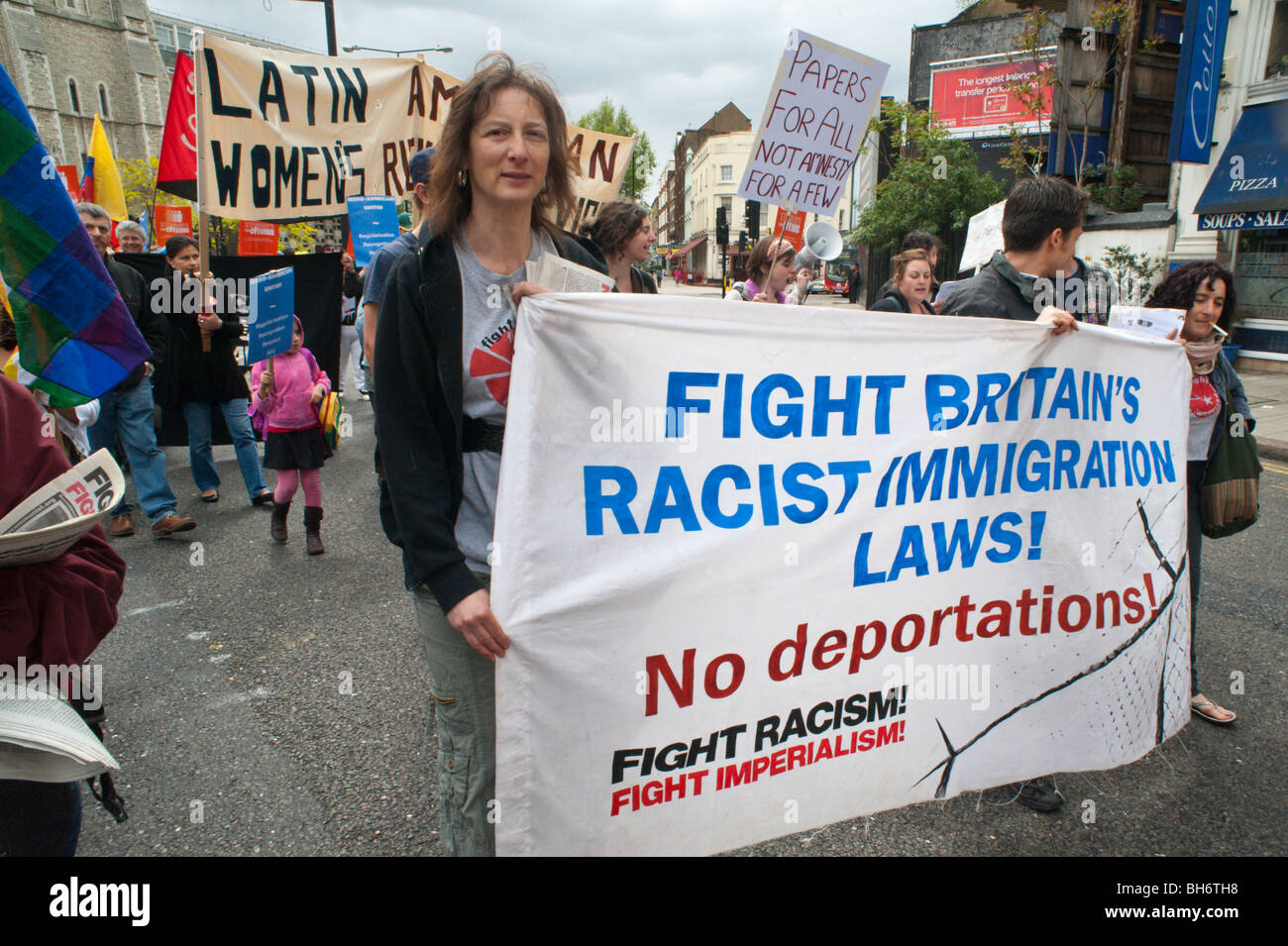 Fight Racism FIght Imperialism banner against deportations at Strangers into Citizens march, London, May 2009 - Stock Image