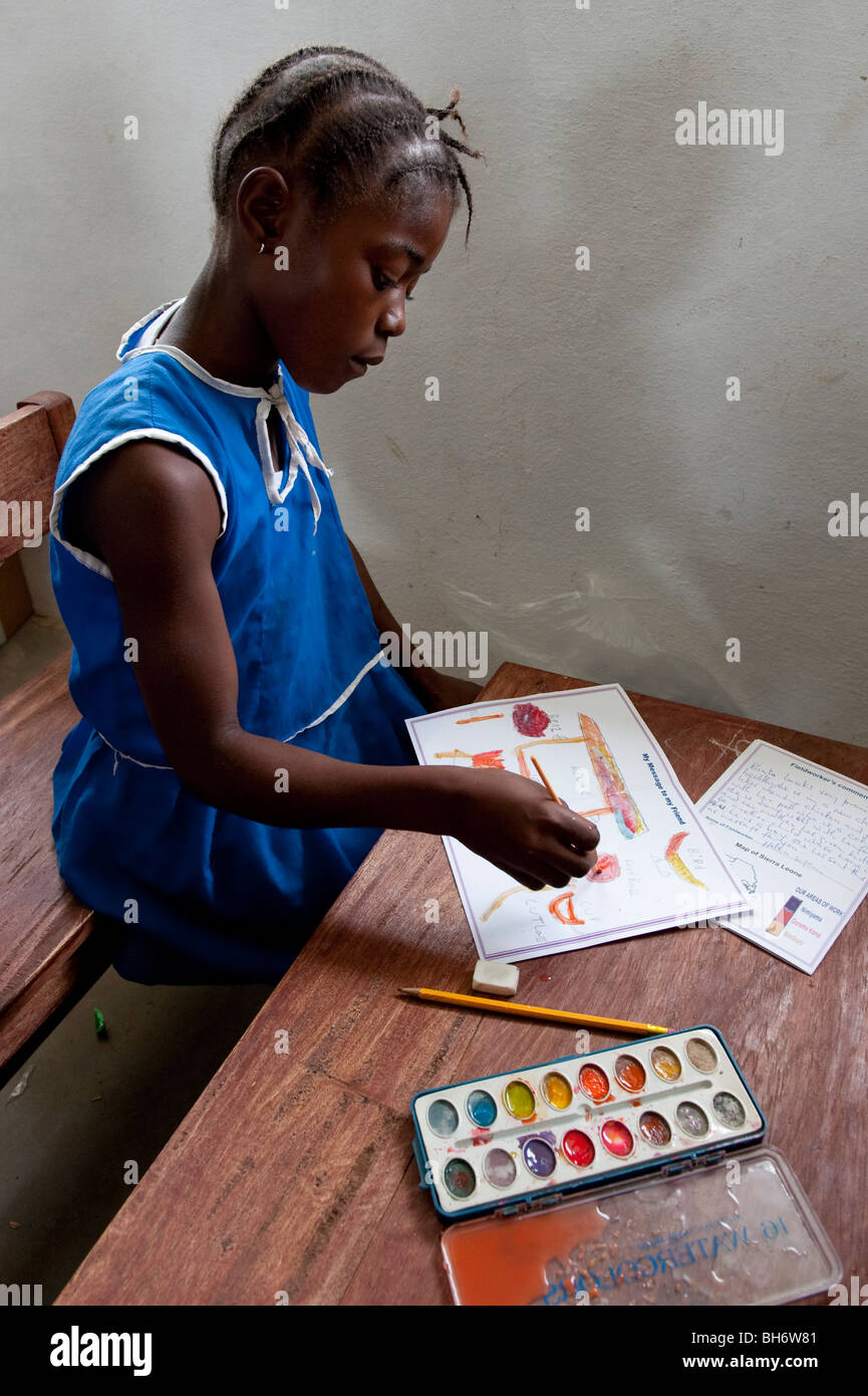 Child writing messages to Sponsors in UK. Condoma School. Sierra Leone - Stock Image
