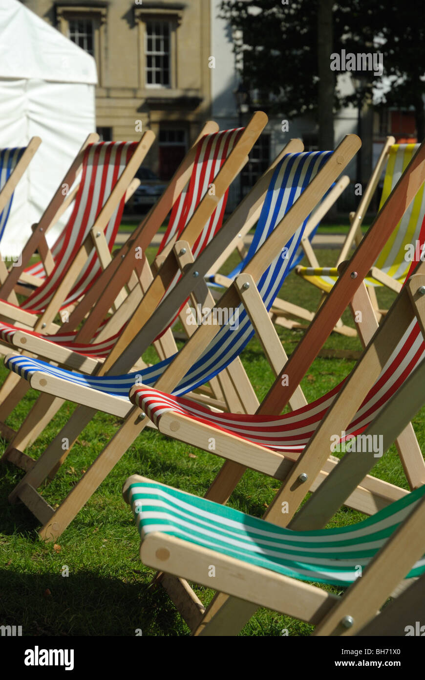 Deckchairs  set out in a city park ready for a summer event performance - Stock Image