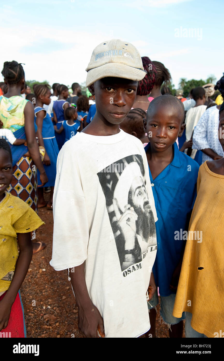 Young man in Osama Bin Laden t-shirt at Village meeting Ngo town Sierra Leone - Stock Image