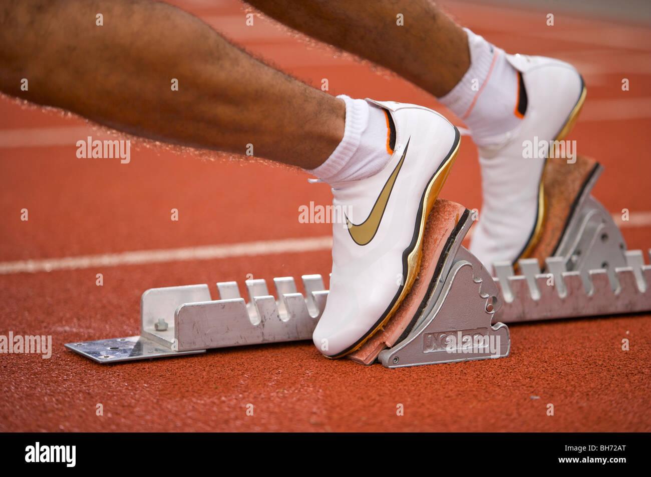 Olympics, 2012, running, track, lanes, athletics, sports, feet, track, field, starting, blocks, sport, cleats, feet, - Stock Image