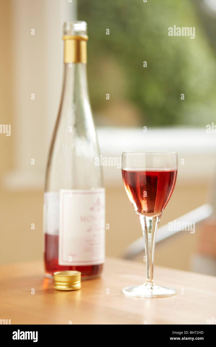 Closeup of a bottle of wine and glass - Stock Image