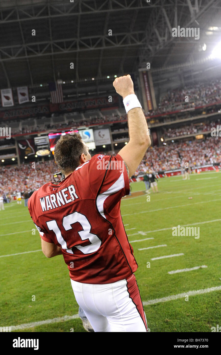 Kurt Warner #13 of the Arizona Cardinals reacts to the crowd after defeating the Green Bay Packers in the NFC wild - Stock Image