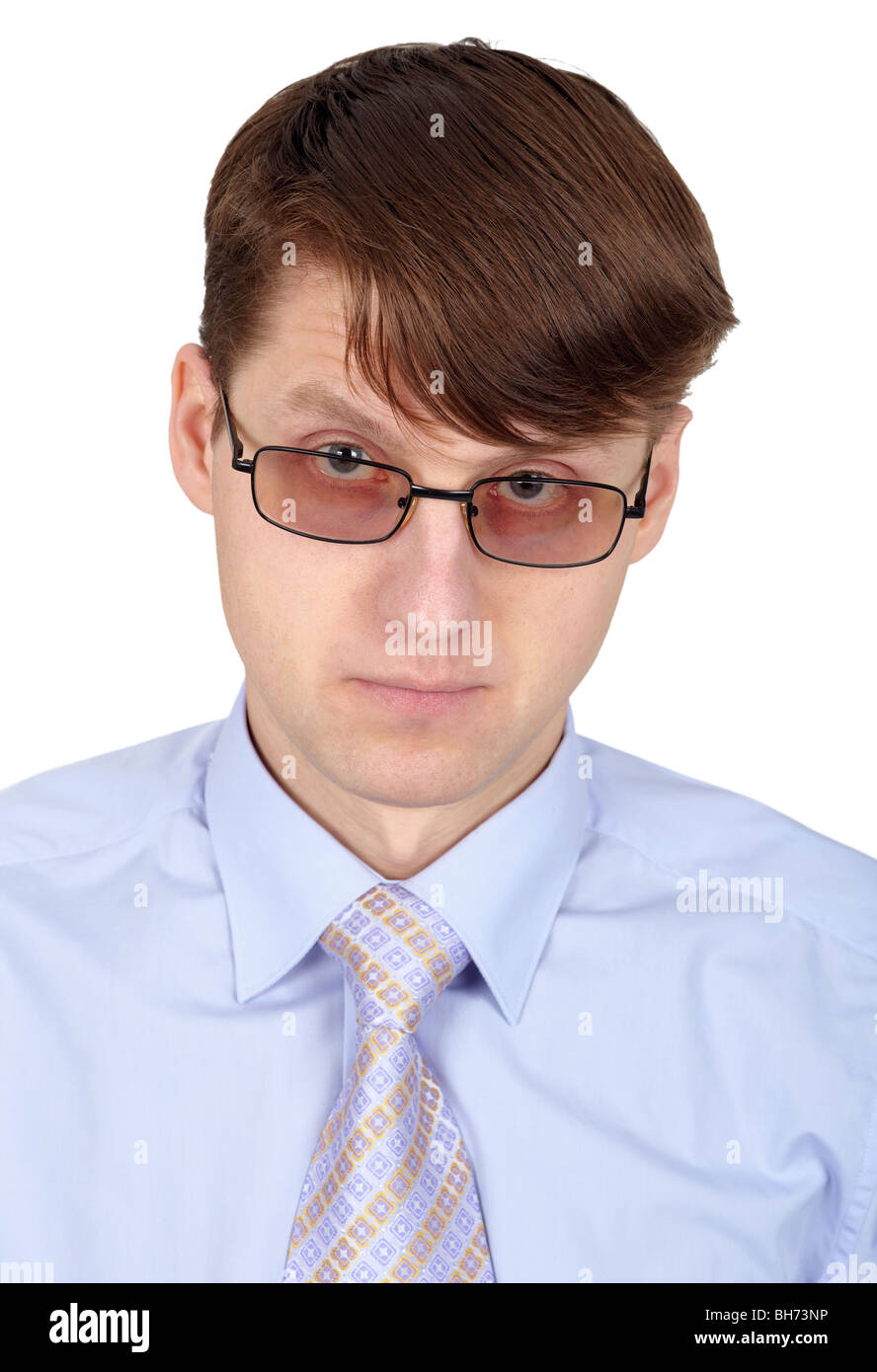 Young handsome man in glasses isolated on white background - Stock Image