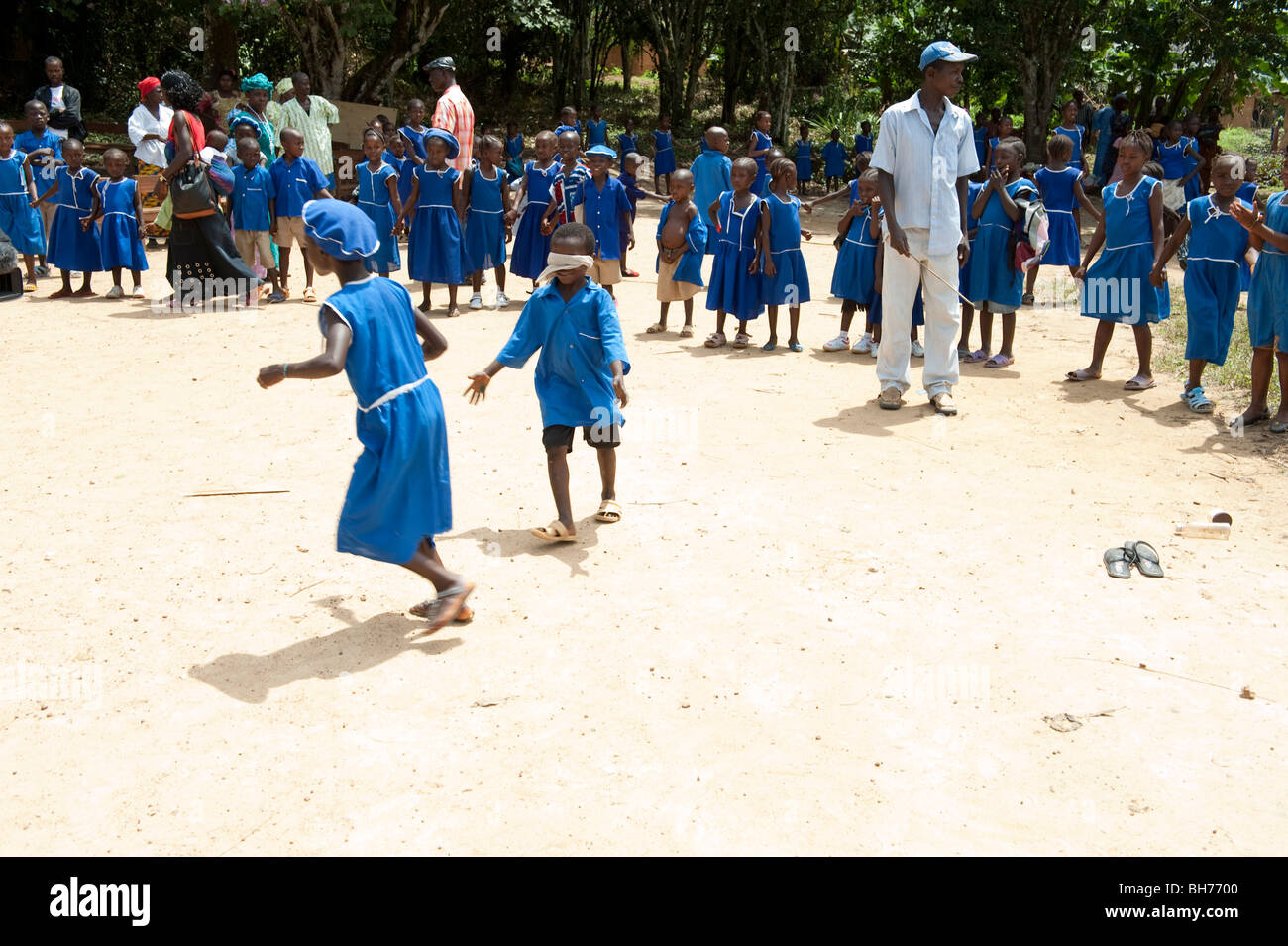 Tinkoko(r). School. Children playing blind mans bluff - Stock Image