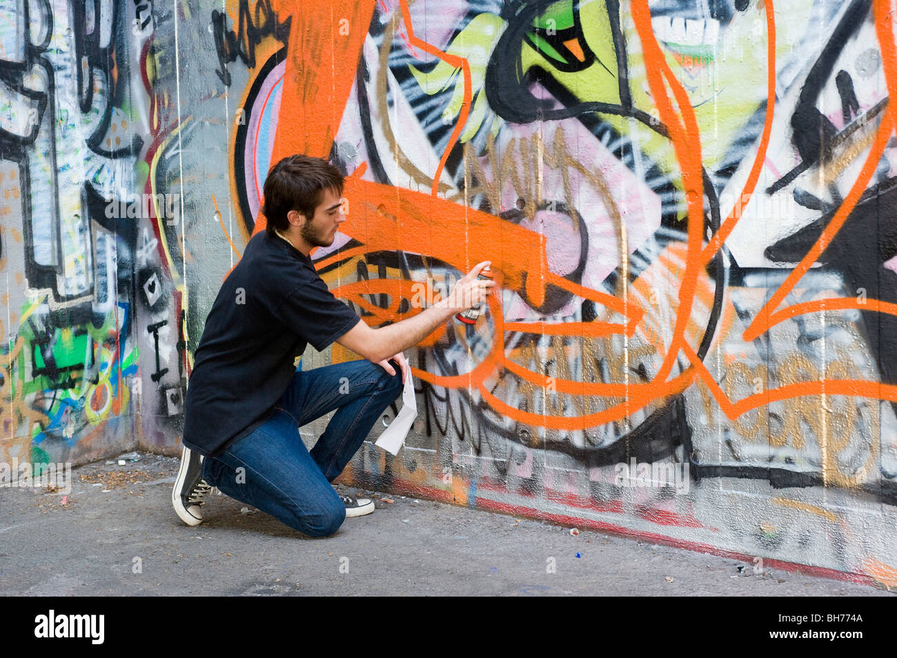 Spray Painting Graffiti On Concrete Wall South Bank London