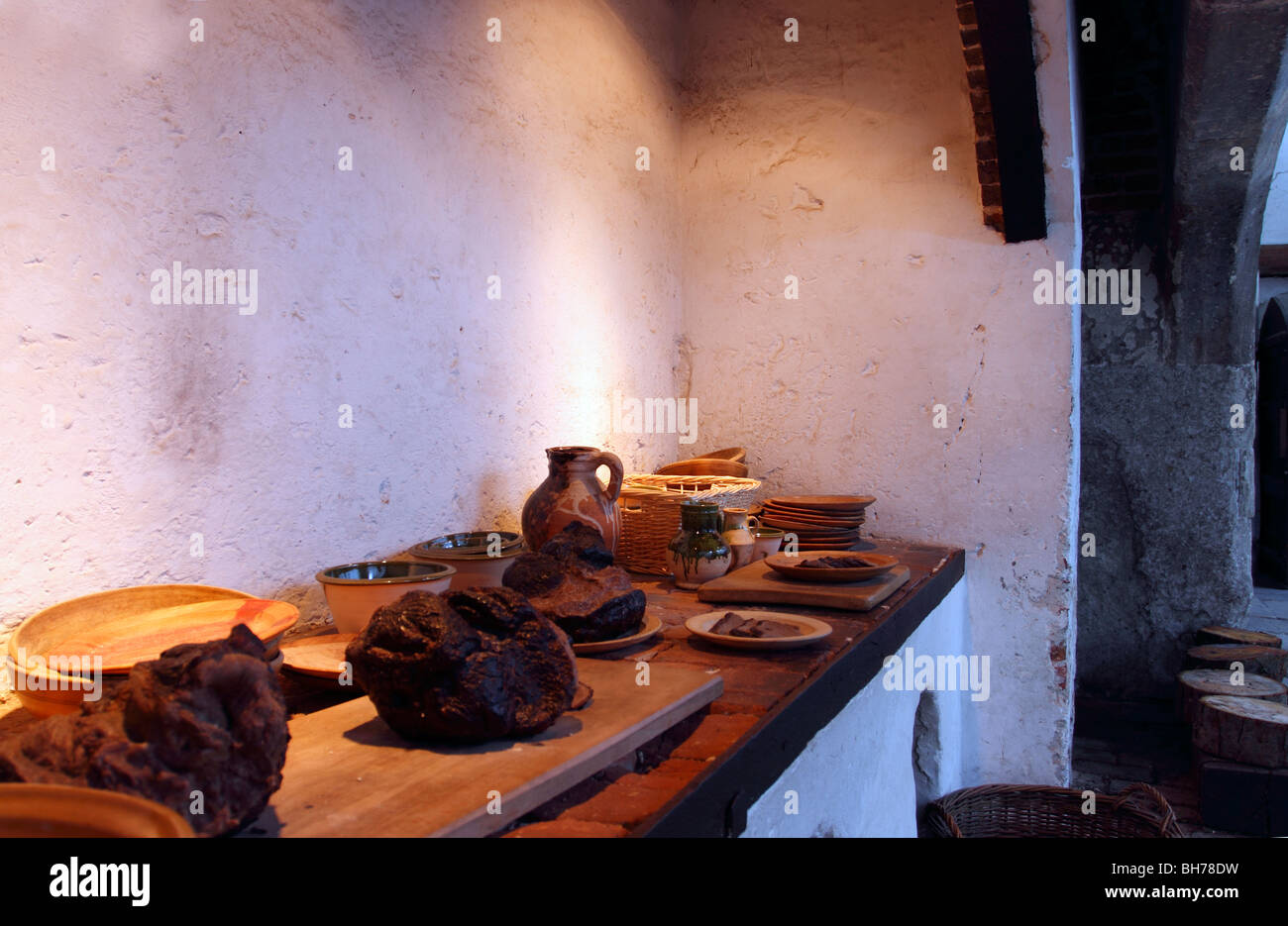 Pots, pans, jugs, meat all in the great kitchens at Hampton Court Palace. Now divided into three large rooms. Originally - Stock Image