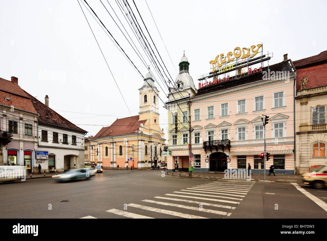 North east corner of Unirii square with Melody Hotel and the Evangelical Lutheran Church in Cluj-Napoca Romania - Stock Image