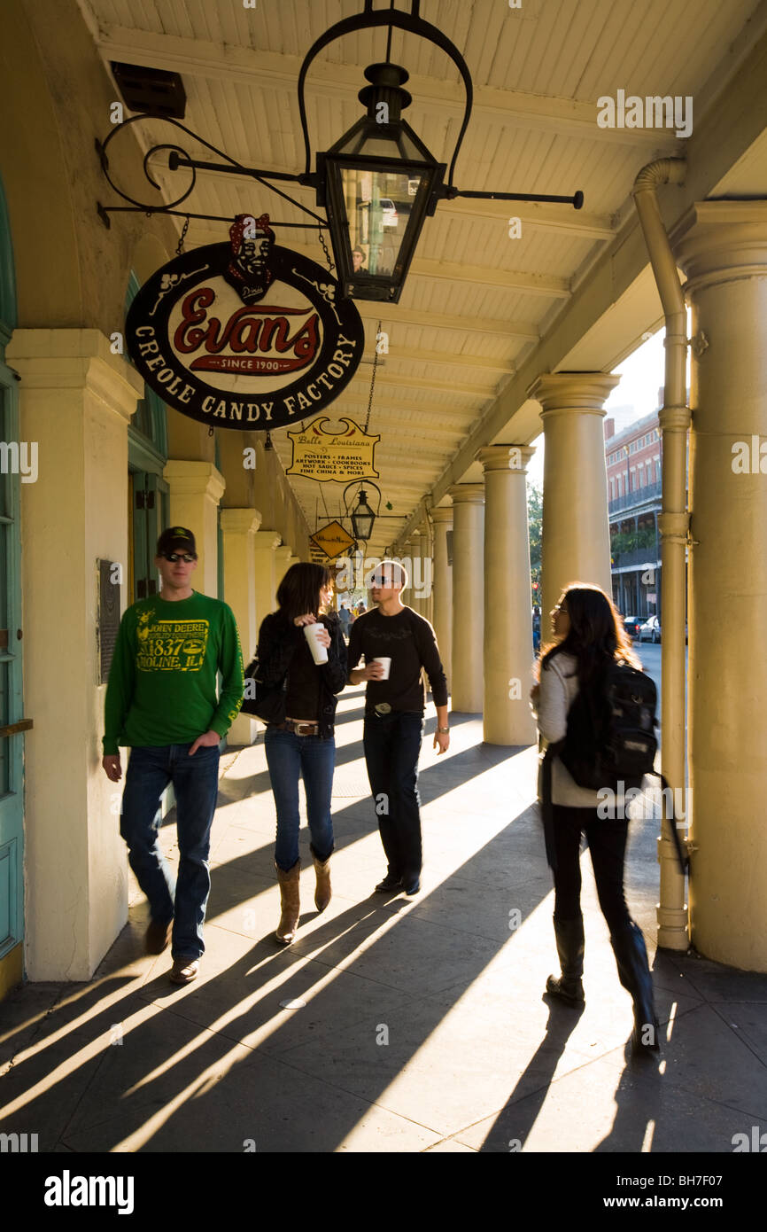 Tourists walking under French Market portico, New Orleans, Louisiana - Stock Image