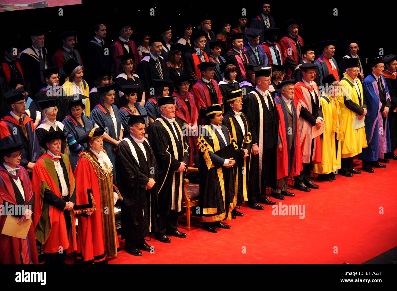 The University of Sussex Chancellor Sanjeev Bhaskar centre stage at the start of the winter graduation ceremony - Stock Image