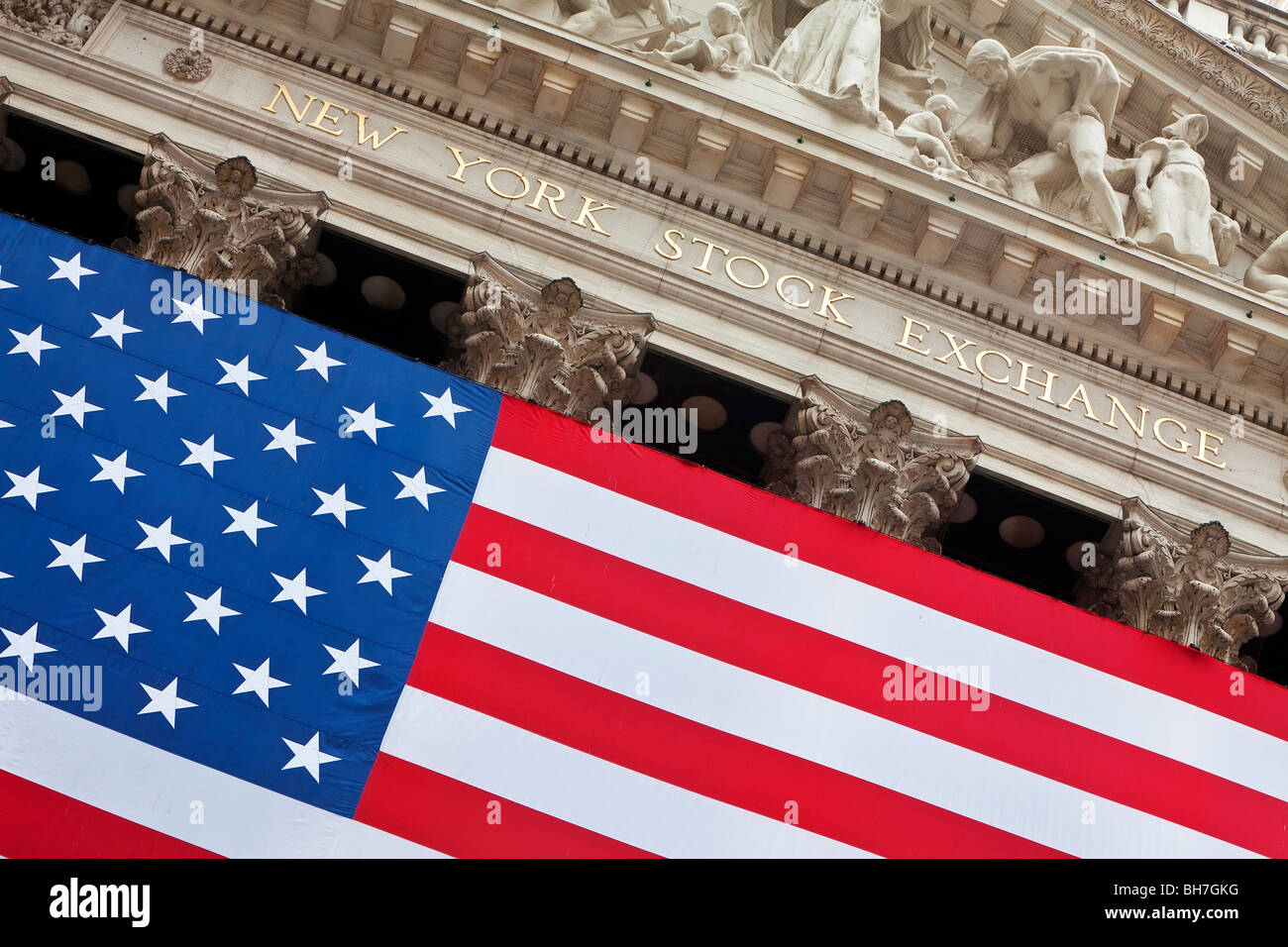 USA, New York City, Manhattan, Downtown Financial District - Wall Street and US flag hanging outside the New York - Stock Image