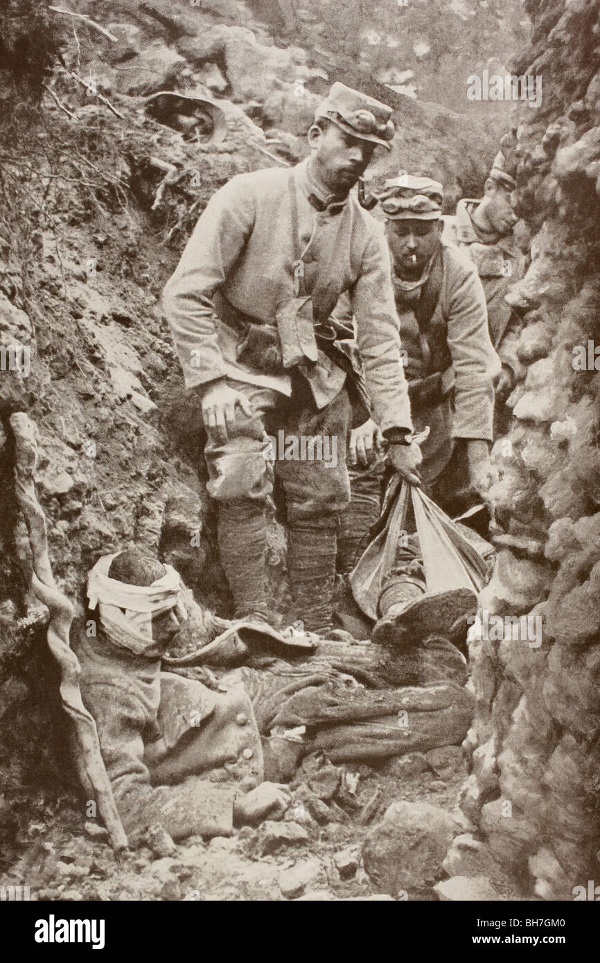 A trench crowded with the wounded and the dead during an action in the Argonne, France during the First World War. - Stock Image