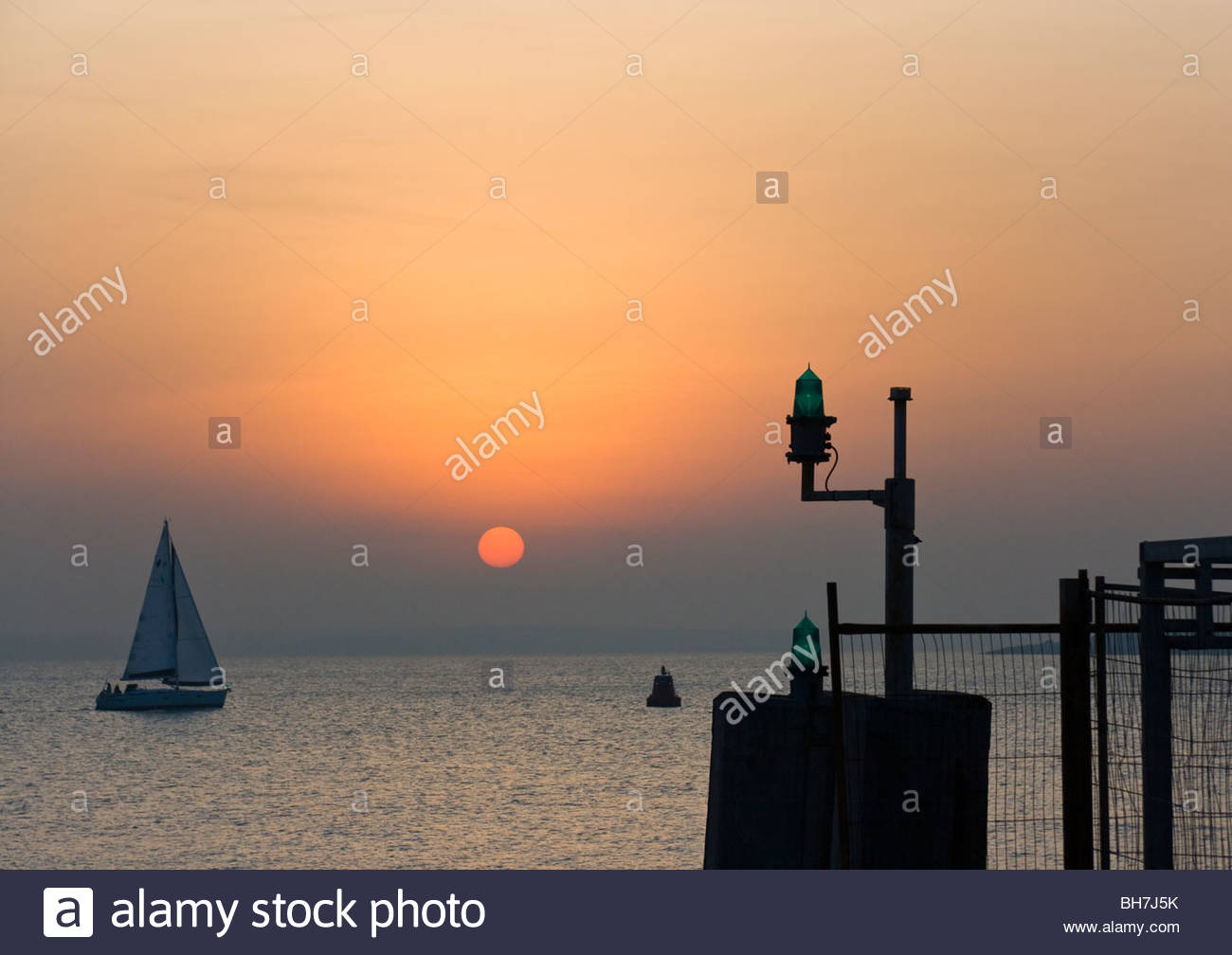 Sail Boat And Sunset From Pier Southsea England - Stock Image