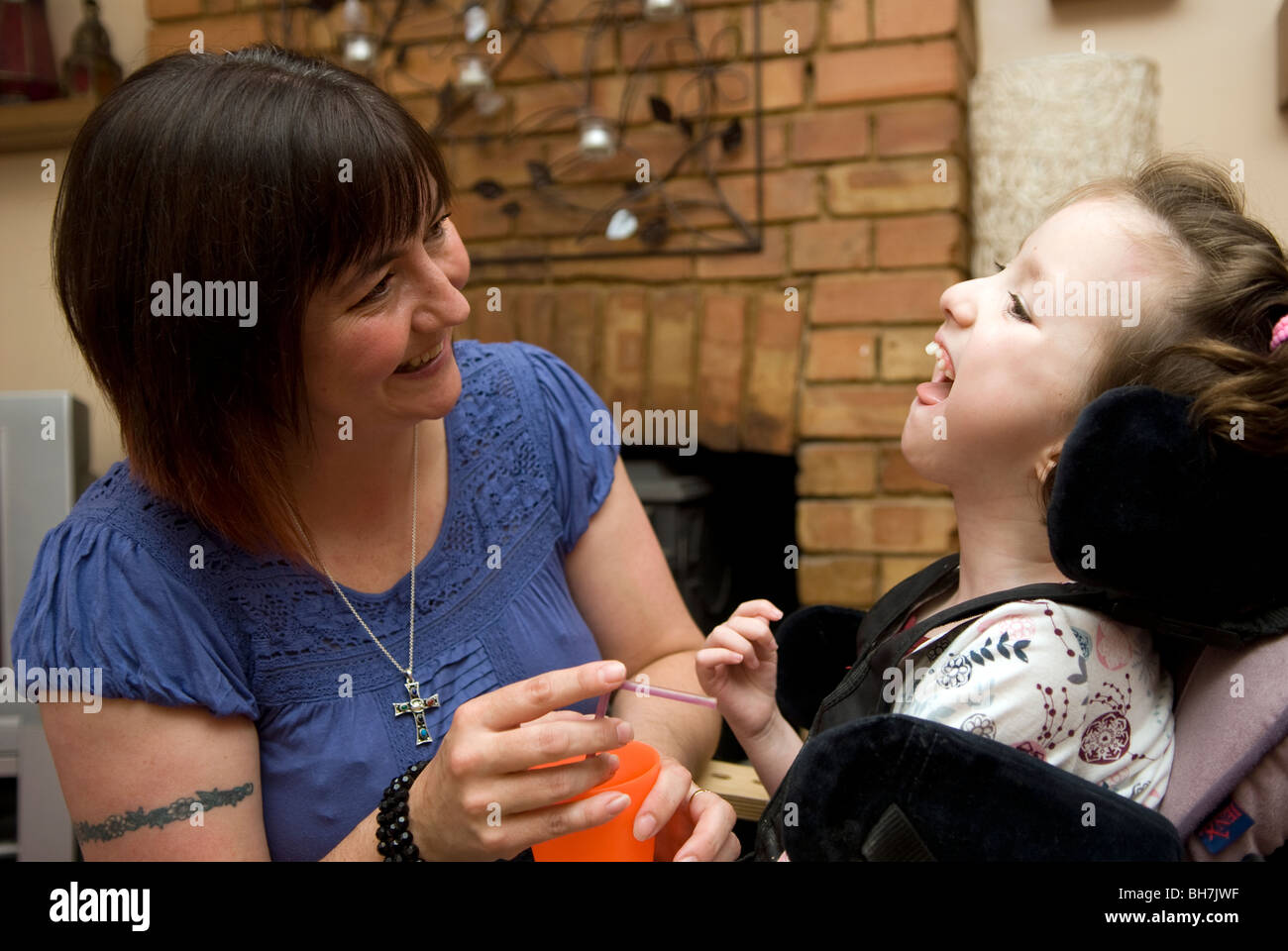 Mother with her disabled daughter (cerebral palsy), Luton, UK. - Stock Image
